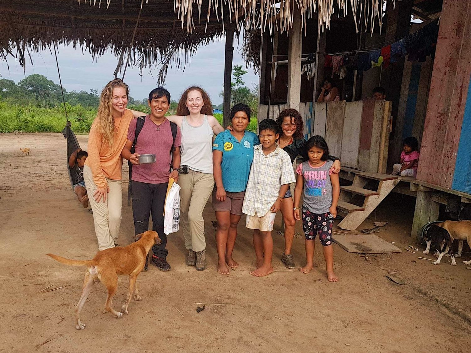 Pictured: Samantha Zwicker and Ronee Collins with members of the Lucerna community